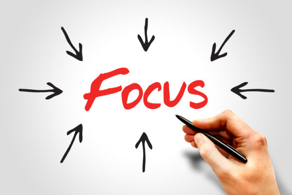 "Arrows surrounding and pointing to the word ""focus"""